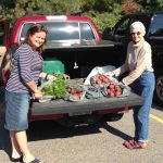 Dorothy(left) and Sam load vegetables on their way to the Manna Food Bank.