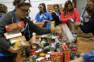 IMG_3774 - Manna volunteers sort groceries