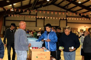 Sorting donated food at the Bracebidge Fairgrounds. October 2013