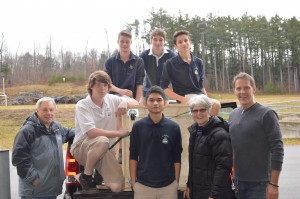 St. Doms students with one of the boxes built for Manna