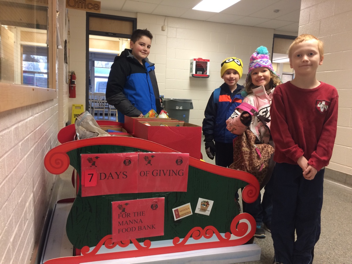 Students from Bracebridge Public School and the food their raised for Manna