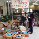 Shannon Boolsen-Vorster and Sam Robinson at BMLSS with a mini-mountain of donations for the 2016 Pasta Challenge.
