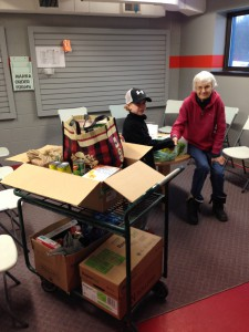 Parker McAdam and Sam Robinson at Manna Food Bank