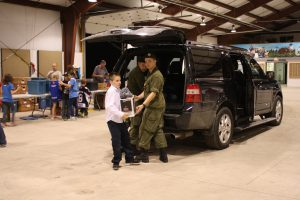 The vehicles bring the food to the Bracebridge Fairgrounds where more volunteers sort it.