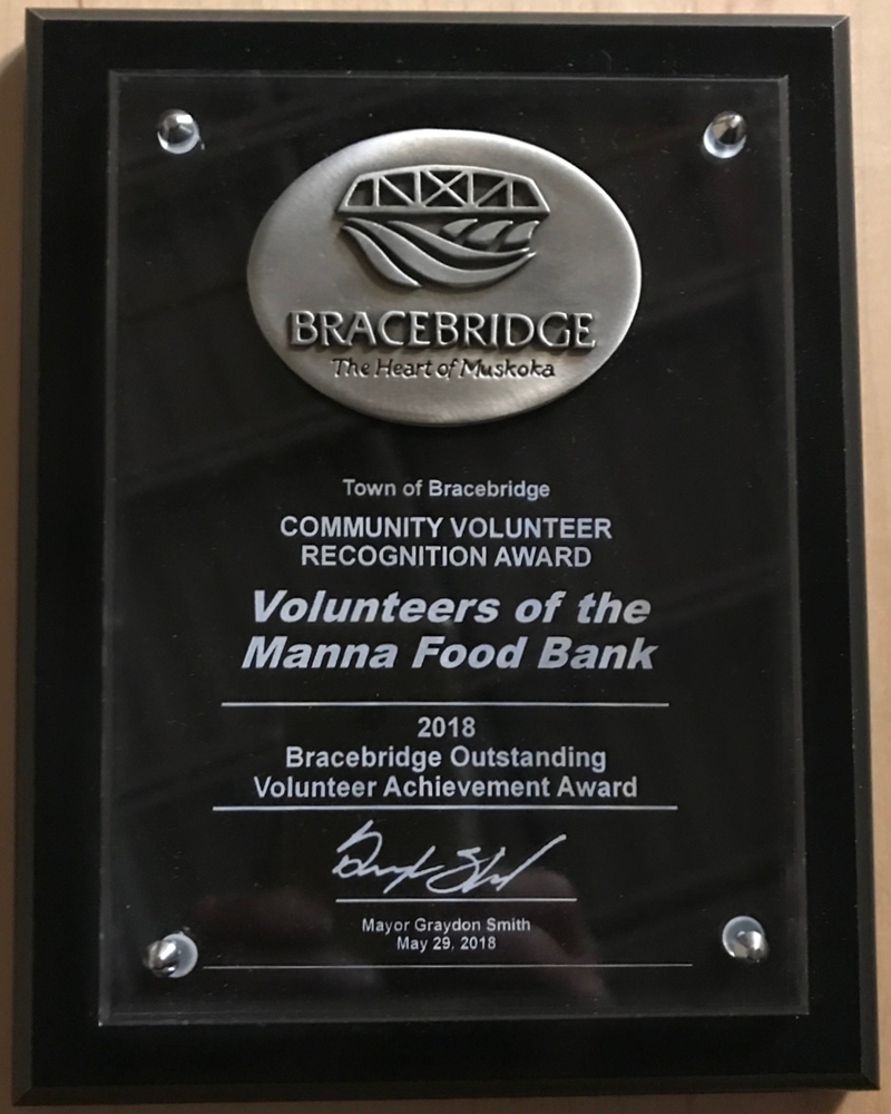 Image of Community Volunteer Recognition Award, presented to the volunteers of the Manna Food Bank by the Town of Bracebridge.