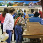 Oldtimers Fall Food Drive volunteers sort donations at the Bracebridge Fairgrounds