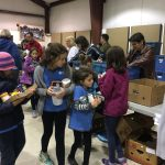 Volunteers sorting food at the fairgrounds