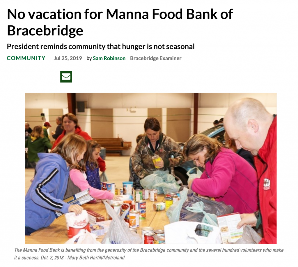 Picture of article from Muskoka Region, includes headline and image of volunteers sorting food at Manna food drive.