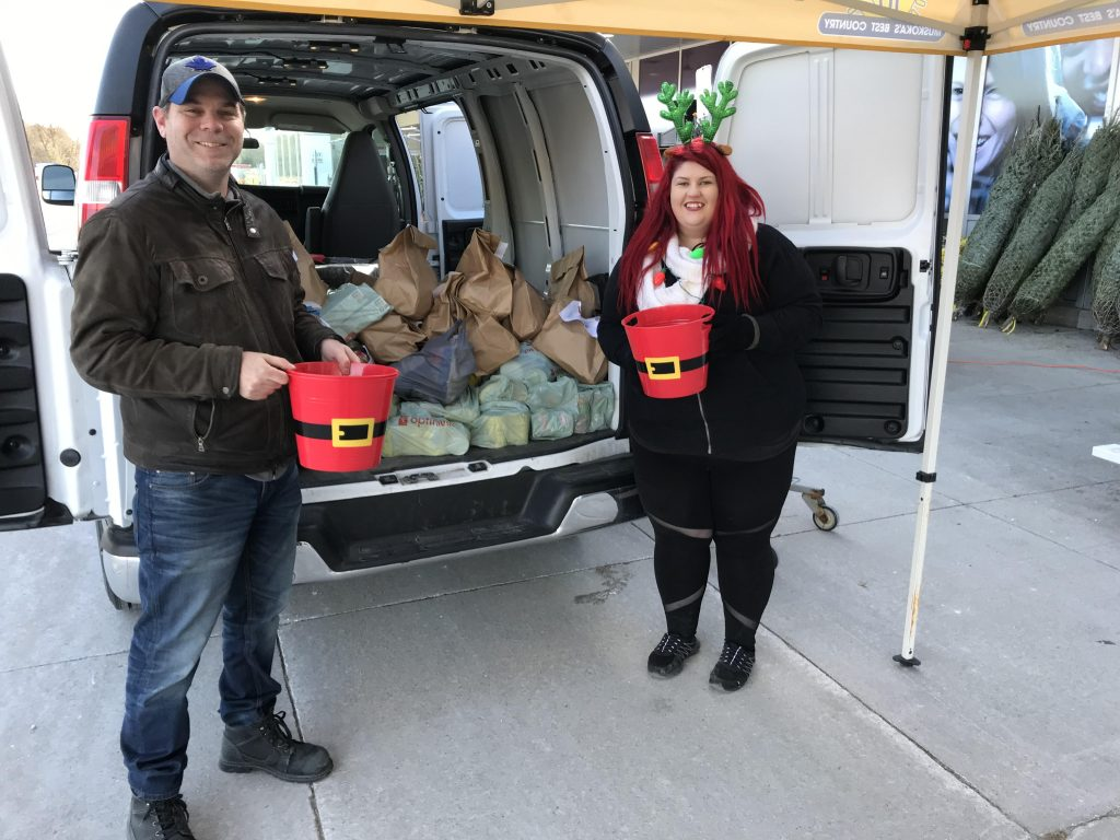 Ryan and Michelle with a van filled with donations